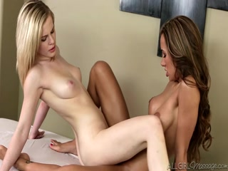 Catie massages away Amia's tension before rubbing her pussy!